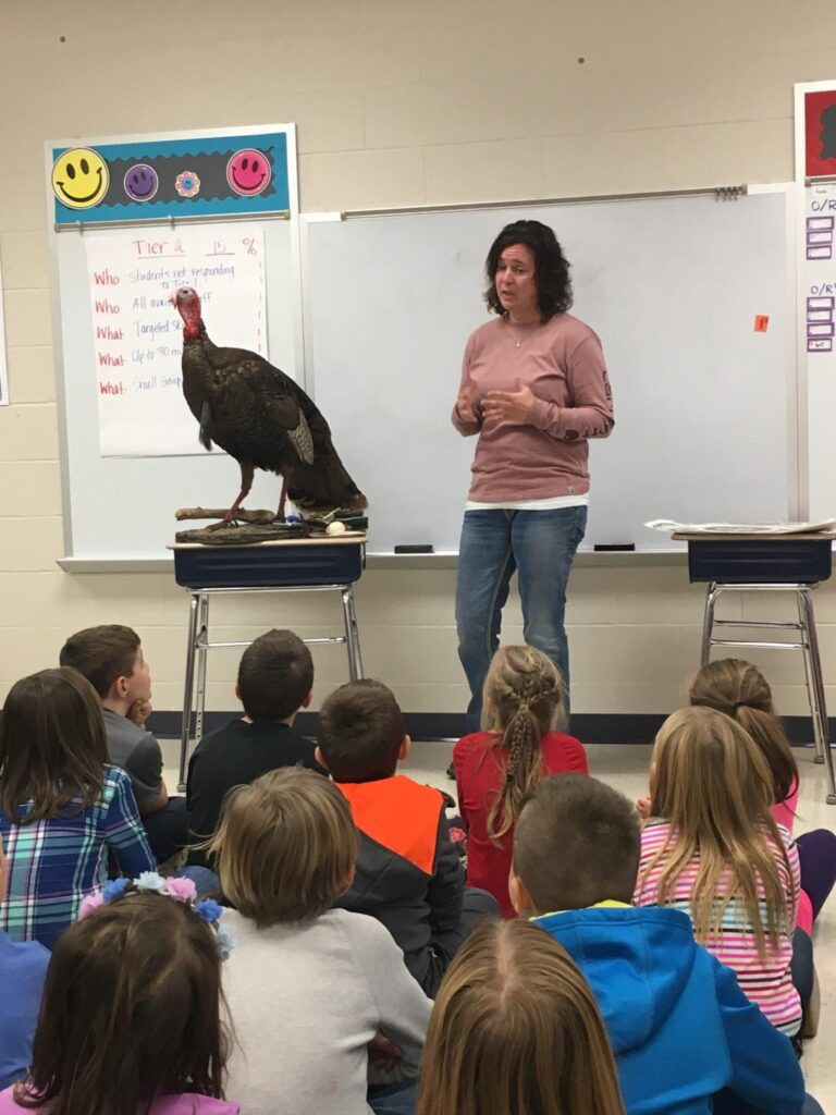 Teacher with a wild turkey